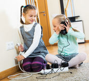 Two girls playing with electricity Stock Image