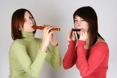 Two girls playing on flute and harp Royalty Free Stock Photo