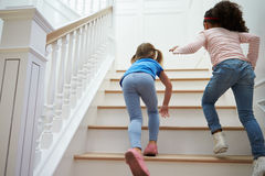 Two Girls Playing Game On Staircase At Home Royalty Free Stock Photography