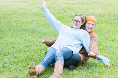 Two Girls Playing on the Grass Stock Images
