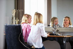 Two Girls Playing With Jewelry And Make Up Royalty Free Stock Photography