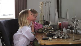 Two Girls Playing With Jewelry And Perfume In Bedroom stock video footage