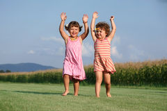 Two girls playing outdoors Stock Photo