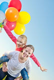 Two girls playing outdoors with balloons Royalty Free Stock Photography