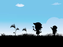 Two girls playing outside. Silhouettes of Children playing outside Royalty Free Stock Photos