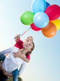 Two girls playing outside with balloons Royalty Free Stock Images