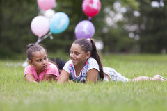 Two girls playing in the park Royalty Free Stock Photos