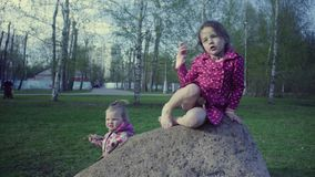 Two girls playing in the park stock footage