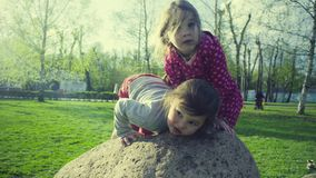 Two girls playing in the park stock video footage
