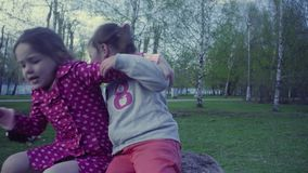Two girls playing in the park stock video