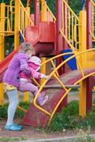 Two girls are playing on the playground Stock Photography