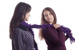 Two girls playing with a scarf Royalty Free Stock Photography