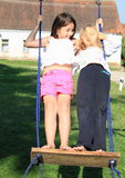 Two girls playing on swing Royalty Free Stock Image