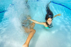 Two Girls Playing Underwater Stock Photo