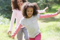 Two Girls Playing In Woods Together Royalty Free Stock Photo