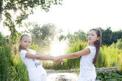 Two girls plays. Two girls play in the park Stock Photos