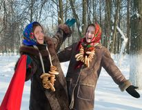 Two girls plays during Pancake Week at Russia Royalty Free Stock Photo