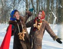 Two girls plays during Pancake Week at Russia Royalty Free Stock Photo