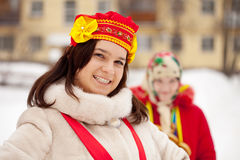 Two  girls plays  Shrovetide at Russia Royalty Free Stock Photo
