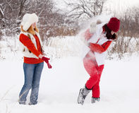 Two Girls Plays With Snow Royalty Free Stock Photography