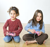 Two girls playstation. Young  girls playing with playstation together Stock Photography
