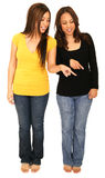 Two Girls Pointing At Ground Stock Photography