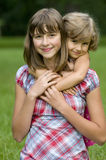 Two girls portrait. Beautiful sisters summer portrait on the grass Stock Photography