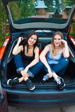Two girls posing in car Stock Photos