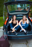 Two girls posing in car Royalty Free Stock Photos