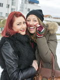 Two girls posing for a funny portrait in winter Royalty Free Stock Images