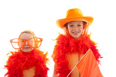 Two girls posing in orange outfit Stock Images