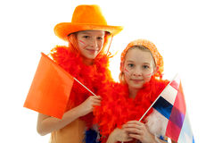 Two girls posing in orange outfit Royalty Free Stock Images