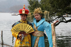Girls posing in traditional Chinese costumes on the shores of West Lake in Hangzhou, China Royalty Free Stock Photography