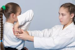 Two girls practice Aikido Stock Image