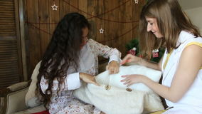 Two girls are preparing a surprise with a pillow.  stock video