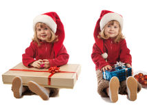Two girls with present boxes Stock Photography