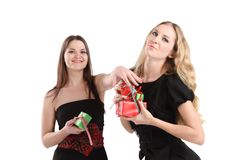 Two girls with presents Royalty Free Stock Photos