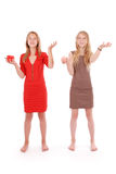 Two girls pretend that juggle fruit Royalty Free Stock Photos