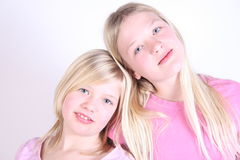 Two girls pretty faces Stock Images