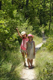 Two girls in Provence forest royalty free stock photo