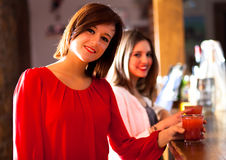 Two girls in a pub Stock Photography