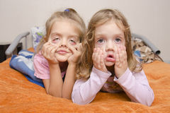 Two girls pulled a terrible faces Stock Photo