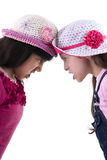 Two Girls in Quarrel. Two Sad Girls in Quarrel Isolated on White Background Royalty Free Stock Images