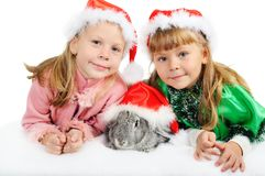 Two girls with a rabbit on white Stock Photo