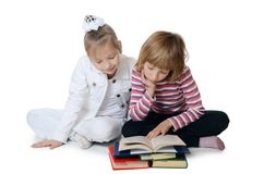 Two girls read the book Stock Photos