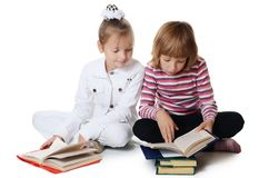 Two girls read the book royalty free stock images