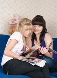 Two girls read magazine Royalty Free Stock Photo