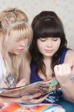 Two girls read magazine Stock Photo