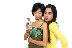Two Girls Reading Bad SMS Stock Photo