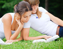 Two girls reading a book Royalty Free Stock Photo